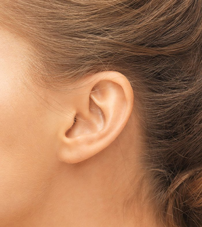 hearing, health, beauty and piercing concept - close up of woman's ear